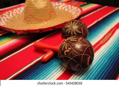 Maracas mariachi cinco de mayo fiesta Mexico poncho sombrero shakers background for Mexican festival souvenir