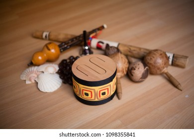 Maracas and percussion instruments made with seeds on wooden background