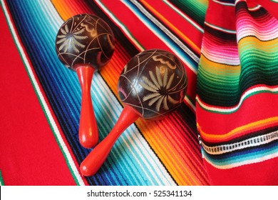 maracas poncho Mexican maraca background serape traditional cinco de mayo Mexico rug blanket fiesta shakers with stripes copy space flat lay minimal simple