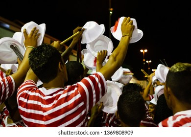 Maracatu de baque virado (nation): manifestation of the popular culture of Pernambuco, Brazil. Batuqueiros before the official parade with hand to the top holding the hats. Recife,  in February 2016.