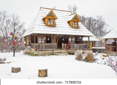 Maramures, Romania - December 03, 2016: A typical wooden house in the Maramures region of Romania during the winter.