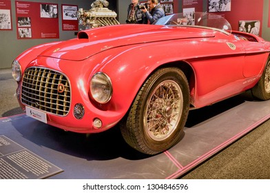 Maranello, Emilia Romagna, Italy. December 2018. At the Ferrari museum the exhibition hall with models of debut. The 250 GT berlinetta and the 166 MM. Enzo Ferrari's memorable statements on the walls.