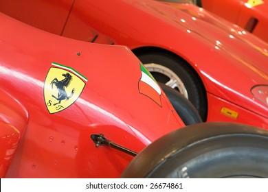 MARANELLO, ITALY - 9 JULY : Logo of Ferrari (Prancing horse) on Formula 1 (F1) sports car in Museum Ferrari, Maranello, Italy on July 9, 2008. Ferrari was founded by Enzo Ferrari in 1928.