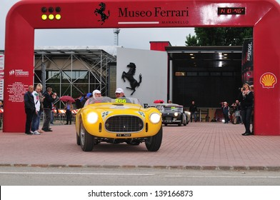 MARANELLO (MO) ITALY - MAY 18: Yellow Ferrari 225 S Vignale spider, built in 1952, exits the Ferrari Museum during the 1000 Miglia historic car race, on May 18, 2013 in Maranello (MO)