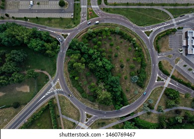 Maranello, Modena/Italy - 07/0172019: Aerail view of a roundabout road with car traffic and small wooded park inside