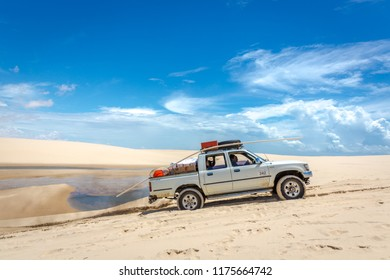 Lençois Maranhenses, Brazil - May 4th 2018 - Group of people in a 4x4 truck crossing the white sand dunes of Lençois Maranhenses National Park in Brazil
