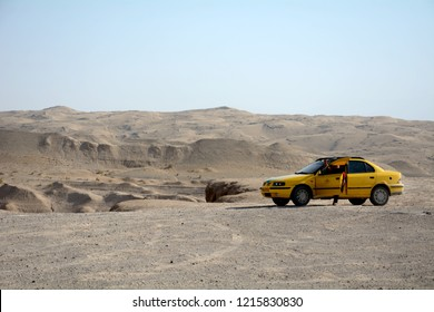 MARANJAB DESERT, IRAN - AUGUST 31: Taxi in the desert at 31 August, 2018 at Maranjab, Iran. Maranjab is a huge desert area close to Kashan.