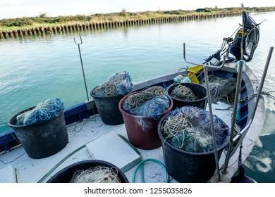 Marano Lagunare, Italy. December 9, 2018. fishing nets on a boat in the harbor