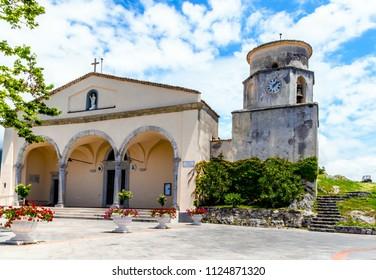 MARATEA, BASILIKATA, ITALY - The catholic church Basilica of San Biagio with bell tower, in the district of Maratea, on the mountain San Biagio, on the Tyrrhenian seacoast in the south of Italy.