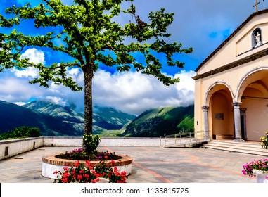 "MARATEA, BASILIKATA, ITALY - The catholic church Basilica of San Biagio with bell tower, in the district of Maratea, on the mountain San Biagio, on the Tyrrhenian seacoast in the south of Italy. """