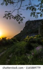 MARATEA, BASILIKATA, ITALY - The old path leads to Mount San Biagio near Maratea. A wonderful sunset in June and blooming wild meadow flowers.