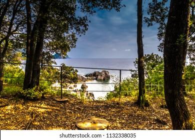 MARATEA, BASILIKATA, ITALY - A place in the shade to relax, on a sunny day, on the rocky coast of the Tyrrhenian sea coast in the south of Italy at Maratea.