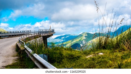 MARATEA, BASILIKATA, ITALY - The winding road with viaduct leading to the summit of Monte San Biagio at Maratea. A view into the mountainous country. on a cloudy day, in the south of Italy
