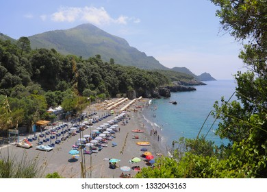 Maratea, Italy - June 2, 2018: Aquamarine beach is a beautiful beach with azure water, framed by mountains and trees