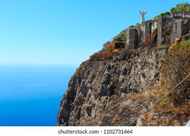 MARATEA, ITALY - JUNE 20, 2017: The San Biagio mountain with the statue of Christ the Redeemer (Cristo Redentore) on Tyrrhenian sea coast near Maratea, Basilicata, Italy