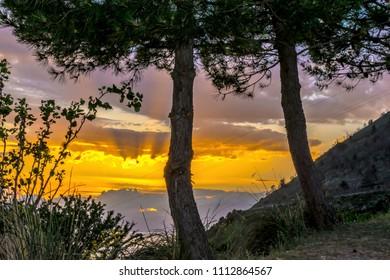 Maratea, Potenza, Basilicata, Italy - A wonderful sunset on in the bay and steep coast of Maratea in June.