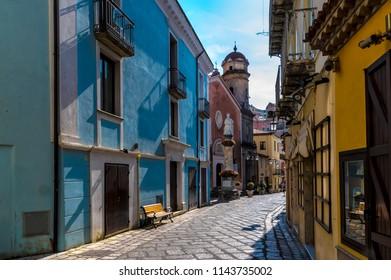 MARATEA, POTENZA, ITALY - A narrow street (Via dell'Unità d'Italia) overlooking the Catholic Church (Chiesa dell'Annunziata) in the old town of Maratea on the coast in the south of Italy.