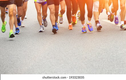 marathon athletes competing in fitness and healthy active lifestyle feet on road