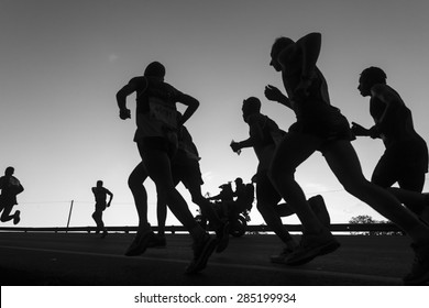 Marathon Runners Black White Durban - South Africa - 31 May - 2015. Comrades Marathon runners on the road action closeup dawn silhouettes .