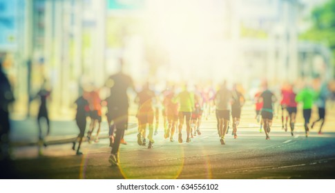 marathon runners in the city background