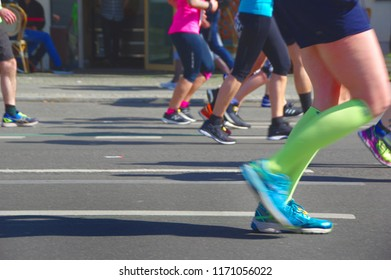 Marathon runner's feet and sport shoes, a fitness and healthy lifestyle concept.