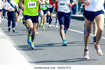marathon runners running on the street