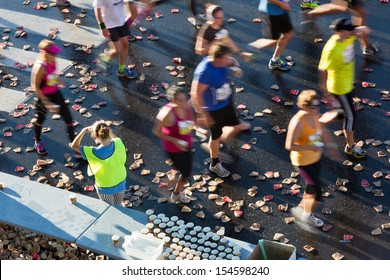 Marathon runners at a water station.