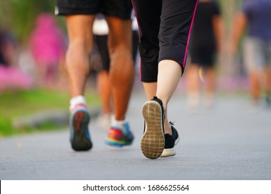 Marathon running Blured of people are walking in urban park. blurred in fitness and healthy active lifestyle feet on road