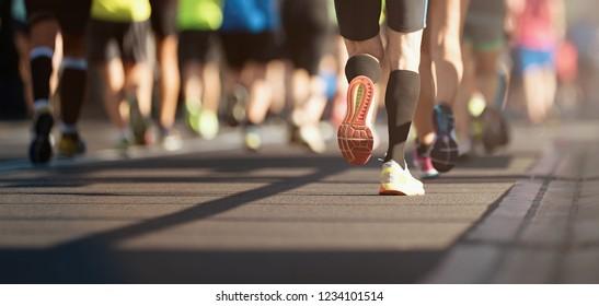 Marathon running in the light of evening, detail on legs