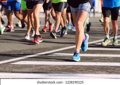 Marathon running race. Legs of marathon runners