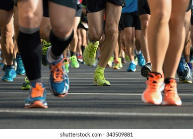Marathon running race, runners feet on road
