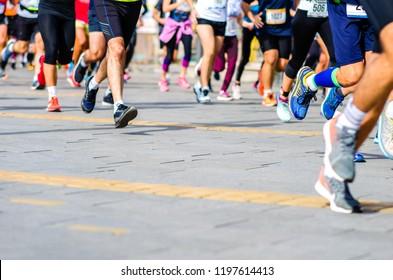 Marathon running race. Runners legs passing in motion.