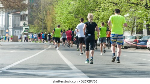 Marathon, street runners  in spring day