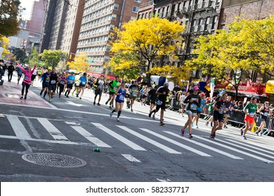 Marathoners and spectators at 16th mile in the Upper East Side, New York City Marathon - November 6, 2016, First avenue and 65th street, New York City, NY, US