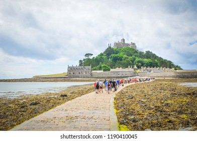 Marazion, England - July 15, 2018: Groups of tourists visit St. Michael's Mount, a major tourist attraction in Marazion, Cornwall.