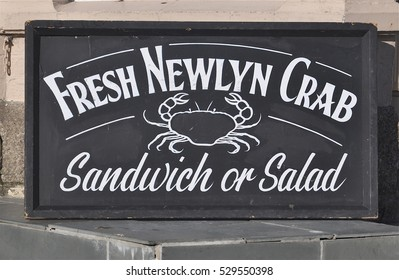 MARAZION, UK - OCTOBER 31, 2016. A hand painted sign outside the Chapel Rock Cafe, located on Kings Road, Marazion, a small coastal town in Cornwall, southwest England, UK.