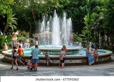 MARBELLA, ANDALUCIA/SPAIN - JULY 6 : Fountain Virgen Del Rocio in the Alameda Park Marbella  Spain on July 6, 2017. Unidentified people