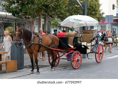 MARBELLA, ANDALUCIA/SPAIN - JULY 6 : Horse and Carriage in Marbella  Spain on July 6, 2017. Unidentified people