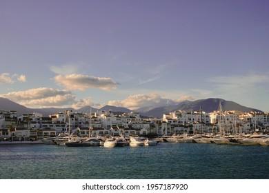 Marbella, Malaga, Spain; 04-11-2021:, yachts, houses and shops in jose banus marina in marbella, malaga.