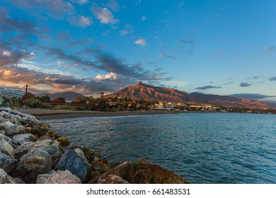 MARBELLA, MALAGA / SPAIN - April 4, 2013: Sunset at the end of April at the coast of Marbella, in southern Andalucia, Spain