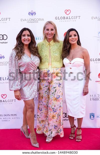 Marbella, Malaga / Spain - July 11 2019 :  Marbella Fashion Show Charity Event in Puerto Banus Marbella. Eva Longoria ambassador Guest. Maria Bravo - Global Gift Foundation and Maria Jose Gozales