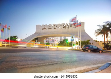 Marbella, malaga/spain - 07 08 2019: Marbella arch sign at dusk with light streaks from long exposure photo.