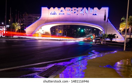 marbella, malaga/spain - 08 18 2019: marbella sign/arch at night time, motion lapse long exposure