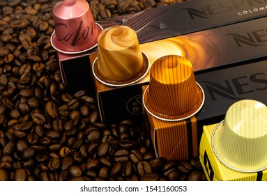 marbella, malaga/spain - 10 23 2019: various nespresso coffee capsules on nespresso boxes, background coffee beans.  nespresso brand coffee