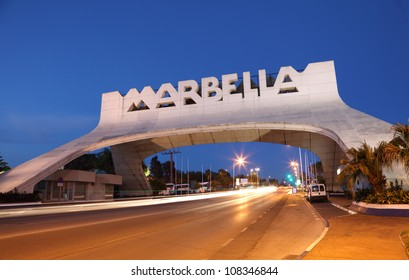 MARBELLA - MAY 21: Marbella Arch at the Costa del Sol illuminated at night on 5th of May 2012 in Marbella, Andalusia Spain. The arch marks the entrance to Marbella and is a icon of the town.