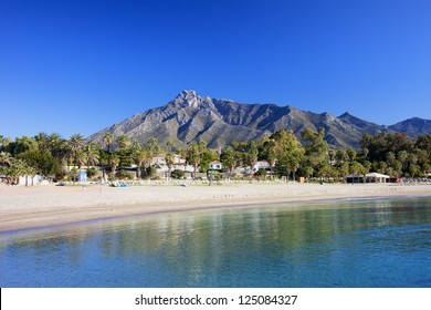 Marbella sandy beach, summer holiday scenery by the Mediterranean Sea in Spain, Andalusia region, Costa del Sol, Malaga province.