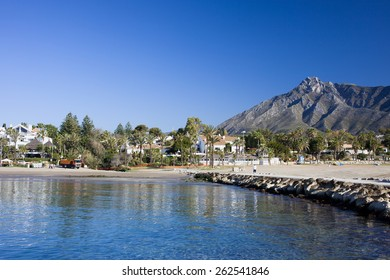 Marbella sandy beach, summer holiday scenery by the Mediterranean Sea in Spain, Andalusia region, Costa del Sol, Malaga province.