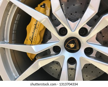 Marbella, Spain - August 10, 2018: Logo of a Lamborghini car parked inside the famous Puerto Banus. Luxury port where you can take a walk, have a drink and see large and luxurious yachts