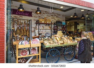MARBELLA, SPAIN - DECEMBER 2017: Woman is discovering street shop with traditional Spanish products.