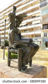MARBELLA, SPAIN - DECEMBER 7, 2015: Sculpture of Don Quixote sitting, designed by Dali in Avenue of the sea, Marbella, Andalusia, Spain